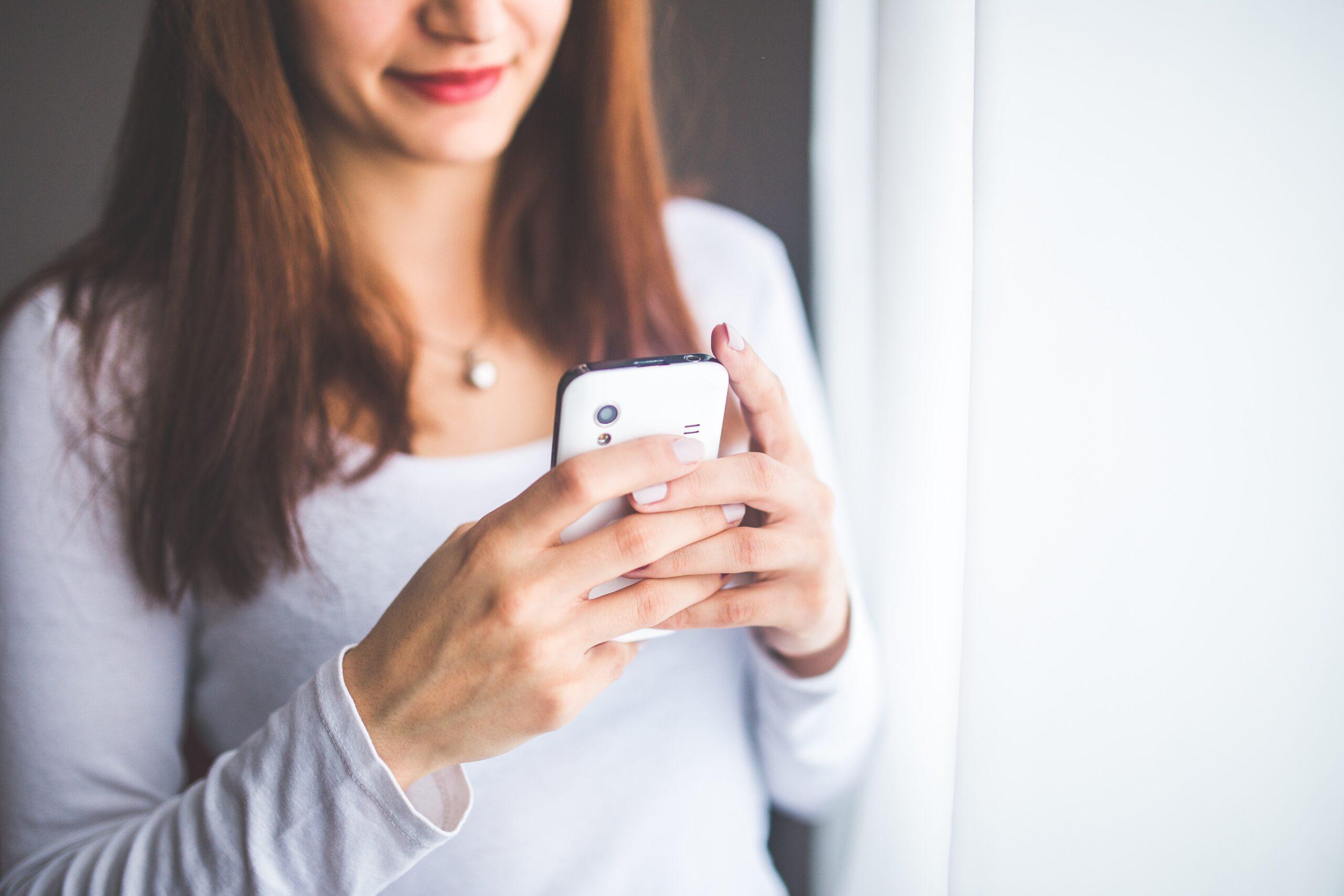 woman checking mobile phone